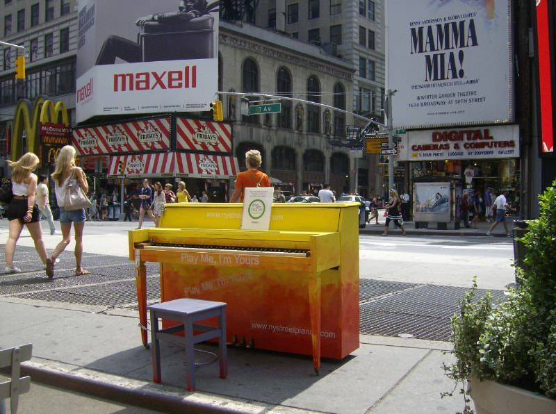 An Orange Piano in Times Square in New York City.
